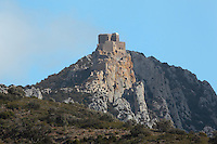 Queribus Castle or Chateau de Queribus, a Cathar castle built 13th-16th centuries, considered the last Cathar stronghold, Cucugnan, Corbieres, Aude, France. It sits on a high peak at 728m, surrounded by steep cliffs. It is one of the Five Sons of Carcassonne or Cinq Fils de Carcassonne, and is listed as a historic monument. The castle has been fully restored, restoration work being completed in 2002. Picture by Manuel Cohen