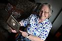 Rev Cynthia Hardiman with a photo of her grandfather, South Shields, Tyne and Wear, Rifleman Albert Penn.