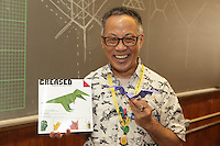 New York, NY, USA - June 23, 2012: Talo Kawasaki teaches a  class how to fold his design, a Patty Bat Action Model (a bat with flapping wings). He is holding a copy of Creased in which the model is described. The OrigamiUSA 2012 Convention held at Fashion Institute of Technology, New York, attracts members from the USA with visitors from Asia, the Americas, and Europe. Attendees exhibit their work and take part in classes, and an exhibition of big folding.
