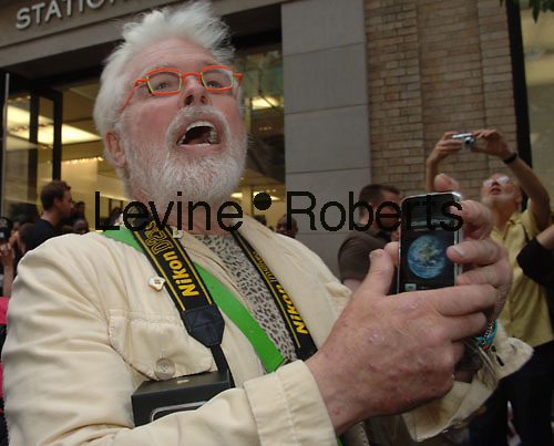 An enthusiastic Apple iPhone purchaser outside the Apple Store  on June 29, 2007.  (© Frances M. Roberts)