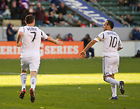 CARSON, CA - March 18,2012: LA Galaxy midfielder Landon Donovan (10) congratulates forward Robbie Keane (7) on his goal during the LA Galaxy vs DC United match at the Home Depot Center in Carson, California. Final score LA Galaxy 3, DC United 1.
