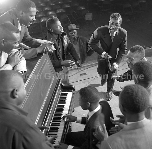 """""""Bo"""" McCann, """"the original Chattanooga Shoeshine Boy,"""" rehearses with pianist Earl Davis, also from Chattanooga, for special appearance at the Third Annual Wilson Shoeshine Contest, Wilson, North Carolina, 1952. Photo by John G. Zimmerman."""
