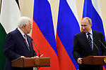 Russian President Vladimir Putin and Palestinian President Mahmoud Abbas attend a joint press conference following their meeting at the Bocharov Ruchei state residence in Sochi, Russia, May 11, 2017. Photo by Thaer Ganaim