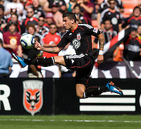 Santino Quaranta (25) of D.C. United takes a first touch on the ball at RFK Stadium in Washington, DC.  The New York Red Bulls defeated D.CC United, 2-0.