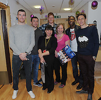 Football-Bolton Wanderers Hospital Visit-Derian House Chorley-20/12/2012-Pictures by Paul Currie-Keep-Andy Lonergan Jay Lynch Adam Bogdan Benik Afobe and Keith Andrews with staff at Derian House hospice in Cholrey Lancashire