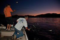 """Fishing Lake Tahoe at Sunset 4"" - These men were photographed catching a Mackinaw while fishing on Lake Tahoe at sunset."