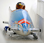 15 December 2007: Germany 1 pilot Sandra Kiriasis, with Romy Logsch on the brakes, exit turn 19 during their first run of the FIBT World Cup Bobsled Competition at the Olympic Sports Complex on Mount Van Hoevenberg, at Lake Placid, New York, USA. Germany 1 took the Gold Medal at the event...Mandatory Photo Credit: Ed Wolfstein Photo