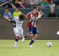 Revolution defender Kevin Alston (30) battles Chivas forward Justin Braun (17) for the ball during the second half of the game between Chivas USA and the New England Revolution at the Home Depot Center in Carson, CA, on September 10, 2010. Chivas USA 2, New England Revolution 0.