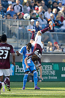 Kosuke Kimura (27) of the Colorado Rapids goes over the top of Lionard Pajoy (23) of the Philadelphia Union while going for a header during the first half of a Major League Soccer (MLS) match at PPL Park in Chester, PA, on March 18, 2012.