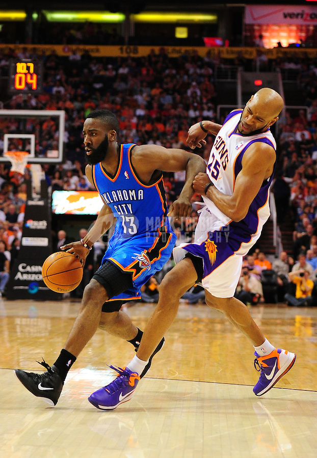 Mar. 30, 2011; Phoenix, AZ, USA; Oklahoma City Thunder guard (13) James Harden drives to the basket against Phoenix Suns guard (25) Vince Carter at the US Airways Center. Mandatory Credit: Mark J. Rebilas-