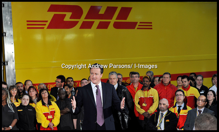 Prime Minister David Cameron holds a question and answer session with workers at the DHL Express Head Quarters in Hounslow, west London, where he was supporting the Conservative candidate Mark Bowen who is standing in next week's Feltham and Heston by-election,  Thursday December 8, 2011. Photo By Andrew Parsons/ i-Images