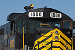 A black locomotive with yellow stripes.