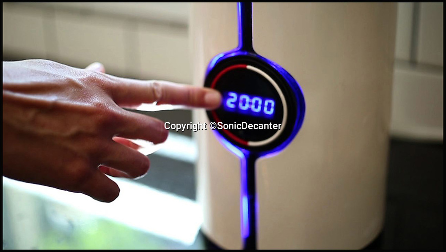 BNPS.co.uk (01202 558833)<br /> Pic: SonicDecanter/BNPS<br /> <br /> *Please use full byline*<br /> <br /> Programming the decanter's timer.<br /> <br /> This futuristic decanter is sending waves through the wine world - because it promises to transform cheap plonk into a much better and more expensive drink in a matter of minutes.<br /> <br /> The Sonic Decanter uses ultrasound to 'age' bargain bottles by altering the compounds in the wine to make it more drinkable.<br /> <br /> Its makers say the high frequency sound waves improve flavour by breaking down preservatives, softening tannins and releasing aromas not normally found in young wine.<br /> <br /> The launch of the Sonic Decanter is planned for June next year and it will cost buyers $249 - around &pound;150.