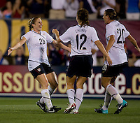 Rachel Buehler (26) of the USWNT celebrates her assist with goal scorer Abby Wambach (20) and Lauren Cheney (12) at Rentschler Field in East Hartford, Connecticut.  The USWNT defeated Sweden, 3-0.