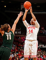 Ohio State Buckeyes guard Ameryst Alston (14) pulls up for a shot against Michigan State Spartans forward Annalise Pickrel (11) during the first half of their NCAA basketball game at Value City Arena in Columbus, Ohio on January 26, 2014.  (Dispatch photo by Kyle Robertson)