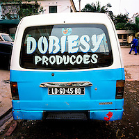 A Candongueiro (communal taxi), parked in a Luanda street, displays the logo of Dobiesy Productions, producers of Kuduru/Kuduro music.