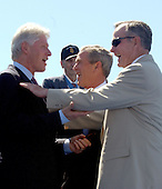 Washington, D.C. - May 29, 2004 -- United States President George W. Bush, center, shares a laugh with former United States Presidents Bill Clinton, left, and George H.W. Bush, right, after he made remarks at the dedication of the World War Two Memorial in Washington, D.C. on May 29, 2004.  Former President Bush seemingly shoves a shocked President Clinton..Credit: Ron Sachs / CNP
