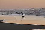 A Palestinian boy plays Football during sunset at the beach of Gaza's sea on January 31, 2015. Photo by Mohammed Asad