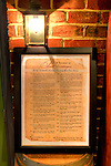 An antique-styled poster, &quot;A Review of Past Vintages,&quot; displayed on a barrel in the shop at The Williamsburg Winery.  High-Dynamic Range (HDR) made this shot possible hand-held and using available light only.