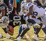 Oakland Raiders running back Jalen Richards (30) tackled by Indianapolis Colts running back Jordan Todman (28) on Saturday, December 24, 2016, at O.co Coliseum in Oakland, California.  The Raiders defeated the Colts 33-25.