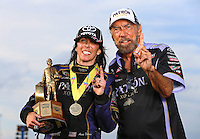 Sept. 1, 2014; Clermont, IN, USA; NHRA  funny car driver Alexis DeJoria (left) poses for a photo with father John Paul DeJoria as they celebrate after winning the US Nationals at Lucas Oil Raceway. Mandatory Credit: Mark J. Rebilas-USA TODAY Sports