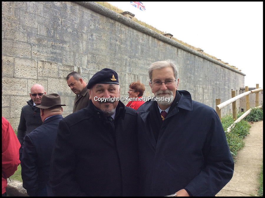 BNPS.co.uk (01202 558833)<br /> Pic: KennethPriestley/BNPS<br /> <br /> ***Please Use Full Byline***<br /> <br /> (L-R): John Gough and Paul Whitehouse. <br /> <br /> Friends and family gathered at the Nothe Fort, Weymouth, Dorset to see Derek's ashes being fired by cannon. <br /> <br /> A former army gunman's dying wish to go out with a bang became a reality when his ashes were fired from a 19th century cannon.<br /> <br /> With the full ceremony of an 1880s officer's funeral carried out by 20 re-enactors, Derek Chatting was given a very special send-off at a fort in Dorset - the first to be held there in more than 100 years.<br /> <br /> Derek served 24 years in the Royal Artillery, working his way up the ranks to Warrant Officer Class 2, and when he realised he was losing his battle with cancer he told his friends and family about the unusual alternative he wanted to having his ashes scattered.<br /> <br /> He died in July, aged 59, after battling brain and lung tumours for nearly four years and his former army pals Kenneth Priestley, Peter Rigby and Nick Mercer started working out how to make his final request happen.