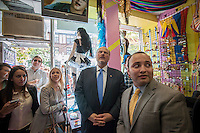 Republican Mayoral candidate Joe Lhota, center, visits small businesses and campaigns on the 37th Avenue business district in the Jackson Heights neighborhood of Queens in New York on Friday, September 27, 2013.  Jackson Heights is a polyglot of ethnic groups ranging from Bangladeshis to South American to Indian to everyone else. (© Richard B. Levine)
