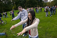 """16 October 2005 - New York City, NY - People following instructions playing on their handheld digital music players walk like zombies across Central Park, New York City, USA, 16 October 2005, during a so-called """"MP3 Experiment"""" organized by Improv Everywhere, a group of young artists which seek to organize bizarre, anonymous happenings and pranks."""