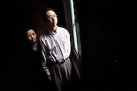 Frank Chen, 33, and his wife, Vicky Yu, 26, of Irvine  are suing Price Waterhouse Coopers for $3.5 million for failing to follow through on a commitment to help Chen get citizenship. Chen, a citizen of China, worked for Price Waterhouse on an H-1B visa, which allows skilled foreigners to work in the United States for up to six years. But Chen got laid off on April 23 and now must return to China. <br />visa.0503.mgk.jpg 05-02-01<br />Photo by Michael Kitada/The Orange County Register