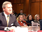 Washington, D.C. - March 23, 2004 -- Carol Ashley of Long Island, left, Martha Sanders of Darien, Connecticut, center, and Ann MacRae of New York City follow the testimony of former Secretary of Defense William Cohen during the hearing of the National Commission on Terrorist Attacks Upon the United States (9/11 Commission) in Washinfgton, DC on March 23, 2004.  All 3 women lost their daughters in the World Trade Center collapse on September 11, 2001.<br /> Credit: Ron Sachs / CNP<br /> [RESTRICTION: No New York Metro or other Newspapers within a 75 mile radius of New York City]