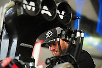 May 5, 2012; Commerce, GA, USA: A crew member for NHRA top fuel dragster Brandon Bernstein (not pictured) works on the engine in the pits during qualifying for the Southern Nationals at Atlanta Dragway. Mandatory Credit: Mark J. Rebilas-