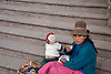 PERUVIAN MOTHER SITS ON STEPS AS BABY WANDERS AWAY