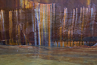 Detail shot of the colorful mineral stains on sandstone cliffs that give Pictured Rocks National Lakeshore its name.