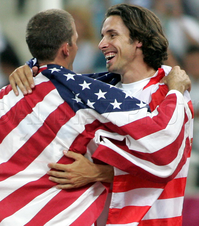 ATHENS, GREECE Ð Timothy Mack celebrates with teammate Toby Stevenson of the United States after winning the Gold and Silver Medals in the Men's Pole Vault on Friday, August 27, 2004 at Olympics Stadium...