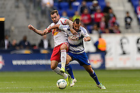Jonny Steele (22) is marked by Andrew Jacobson (4) of FC Dallas during a Major League Soccer (MLS) match at Red Bull Arena in Harrison, NJ, on September 22, 2013.