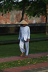 A woman takes a morning stroll outside the Citadel in Hue, Vietnam. April 22, 2013.