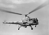"""The H-5 """"Dragon Fly"""", originally designated the R-5 (H for Helicopter; R for Rotorcraft), was designed to provide a helicopter having greater useful load, endurance, speed, and service ceiling than the R-4. The first XR-5 of four ordered made its initial flight on August 18, 1943. In March 1944, the United States Army air Force (AAF) ordered 26 YR-5As for service testing, and in February 1945, the first YR-5A was delivered.   During its service life, the H-5 was used for rescue and mercy missions throughout the world. It gained its greatest fame, however, during the Korean War when it was called upon repeatedly to rescue United Nations' pilots shot down behind enemy lines and to evacuate wounded personnel from frontline areas.   More than 300 H-5s had been built by the time production was halted in 1951..Credit: U.S. Air Force via CNP"""