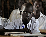 A boy in a classroom in Detang, a small village across the Upper Nile River from Malakal, in Southern Sudan. Teachers in this school are participating in a training program run by Solidarity with Southern Sudan, an international network of Catholic groups supporting Southern Sudan with educational personnel and prayer. NOTE: In July 2011 Southern Sudan became the independent country of South Sudan.
