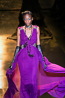 Aminata Niaria walks runway in a amethyst georgette gown, from the Badgley Mischka Fall 2011 fashion show, during Mercedes-Benz Fashion Week Fall 2011.