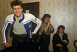 Stuart Adamson,Big Country on tour Scotland. Dressing room with two girl fans, groupies. He is near his family home and will drive his motor bike to go home that evening rather than in the band hotel.