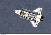"In Earth Orbit - July 6, 2006 -- The Space Shuttle Discovery flies near the International Space Station for docking but before the link-up occurred, the orbiter ""posed"" for a thorough series of inspection photos. Leonardo Multipurpose Logistics Module can be seen in the shuttle's cargo bay. Discovery docked at the station's Pressurized Mating Adapter 2 at 9:52 a.m. CDT, July 6, 2006..Credit: NASA via CNP"
