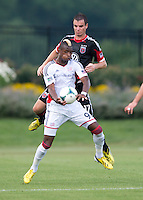 Conor Shanosky (17) of D.C. United stays close to Dimitry Imbongo (92)  of the New England Revolution during the quarterfinals of the US Open Cup at the Maryland SoccerPlex in Boyds, Md.  D.C. United defeated the New England Revolution, 3-1.