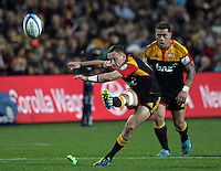 Chiefs' Aaron Cruden watched by Mahonri Schwalger takes a kick against the Crusaders in the semi-final Super Rugby match, Waikato Stadium, Hamilton, New Zealand, Friday, July 27, 2012.  Credit:SNPA / David Rowland
