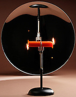 CANDLE BURNING AT BOTH ENDS<br /> Illusion In a Spherical Concave Mirror<br /> (Variations Available)<br /> An object at the center of curvature forms a real ,inverted image the same size as the object. Image distance is the same as object distance. We see a candle burn at one end- flame up and its overlapping image-flame down.