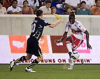 Robbie Keane, Tony Tchani. Tottenham defeated the New York Red Bulls, 2-1.
