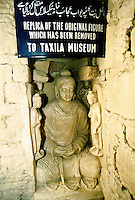 Replica of sculpture of Buddha in the Buddhist city of Taxila in the Swat valley in Pakistan..Taxila, the main centre of Gandhara, is over 3,000 years old. Taxila had attracted Alexander the great from Macedonia in 326 BC, with whom the influence of Greek culture came to this part of the world. Taxila later came under the Mauryan dynasty and reached a remarkable matured level of development under the great Ashoka. During the year 2 BC, Buddhism was adopted as the state religion, which flourished and prevailed for over 1,000 years, until the year 10 AD. During this time Taxila, Swat and Charsadda (old Pushkalavati) became three important centers for culture, trade and learning. Hundreds of monasteries and stupas were built together with Greek and Kushan towns such as Sirkap and Sirsukh, both in Taxila.