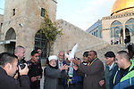Ahmad Khalaf looks on as a religious leader together with others release a dove outside the al-Aqsa mosque the day after he was released from an Israeli prison, in Jerusalem's old city December 31, 2013. Israel freed 26 Palestinian prisoners, on Tuesday, days before U.S. Secretary of State John Kerry was due back in the Middle East to press the two sides to agree a framework peace deal. Photo by Saeed Qaq
