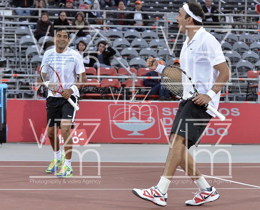BOGOTÁ -COLOMBIA. 20-07-2013. Purav Raja (IND)(I)/ Dijiv Sharan (IND)(D) celebran tas ganar el juego contra Edouard Roger-Vasselin (FRA)/Igor Sijsling (HOL) en dobles en final del ATP Claro Open Colombia 2013 realizado hoy en el Centro de Alto Rendimiento en la ciudad de Bogotá. La pareja de indues ganaron en el torneo ATP tour 250 en la categoría de dobles. / Purav Raja (IND)(L)/ Dijiv Sharan (IND)(R)  celebrate atferwinning the match against Edouard Roger-Vasselin (FRA)/Igor Sijsling (HOL) on the final of the ATP Claro 2013 today at Centro Alto Rendimiento in Bogota city. The  hindu couple won the first place on the ATP tour 250 in doubles category. Photo: VizzorImage / Str