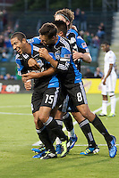 San Jose Earthquakes celebrate with Justin Morrow (15) after his goal. The Chicago Fire defeated the San Jose Earthquakes after going 5-4 on penalty kicks, after a 2-2 score in regulation during the US Open Cup at Buck Shaw Stadium in Santa Clara, California on May 24th, 2011.