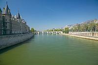 The Conciergerie on Ile de la Cite on the left, and the Pont Neuf over the Seine in the distance, Paris France